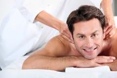 Man having massage Stock Photos