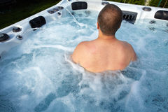 Man having massage in hot tub spa. Man having massage in hot tub Jacuzzi. Spa background royalty free stock images