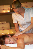Man Having Massage In Spa Stock Photos