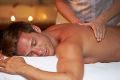 Man Having Massage In Spa. From Female Masseuse royalty free stock photos