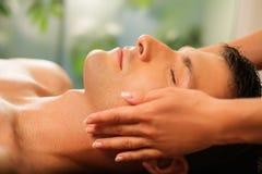Man having massage in spa Royalty Free Stock Image