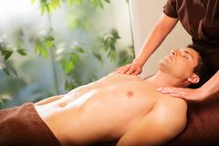 Man having massage in a spa Stock Image
