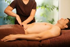Man having massage in spa Stock Photography