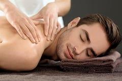 Man having massage in salon. Man having massage in spa salon stock photography