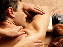Man having massage in the spa salon Royalty Free Stock Photos