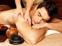 Man having massage in the spa salon Stock Photography