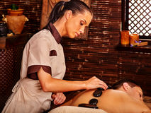 Man having massage stones spa treatment. Royalty Free Stock Images