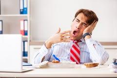 The man having meal at work during break. Man having meal at work during break royalty free stock photos