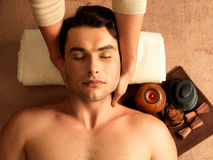 Man having neck massage in the spa salon. Masseur doing neck massage on man in the spa salon royalty free stock photo