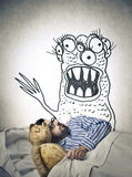 Man having a nightmare. Man into bed holding his teddy bear having a nightmare Stock Photo
