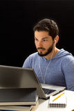 Man having online lessons through the internet. Stock Image