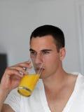 Man having orange juice Royalty Free Stock Photos