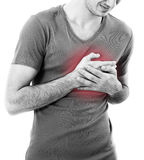 Man having a pain in the heart area Royalty Free Stock Images