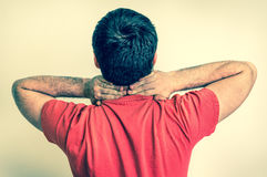Man having pain in his neck - retro Royalty Free Stock Images