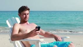 Man having phone call at the beach stock video footage