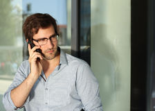 Man having phone conversation Stock Photo