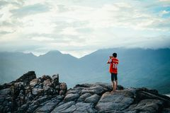 Man Having a Picture on Rock Stock Photography