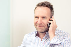 Man having a pleasant conversation on the mobile Royalty Free Stock Photography