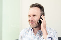 Man having a pleasant conversation on the mobile Royalty Free Stock Photos