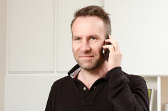 Man having a pleasant conversation on the mobile Stock Photo