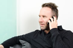 Man having a pleasant conversation on the mobile Stock Image