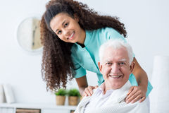 Man having private care. Image of elderly men having private home care Royalty Free Stock Photo