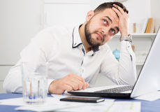 Man having problem in office. Male employee having complicated issue in project in office Royalty Free Stock Photos