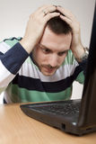 Man having problems with laptop Stock Images