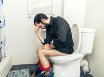 Man having problems in toilet royalty free stock image