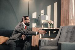 Man having psychiatric problems shaking hand of his imaginary friends royalty free stock image