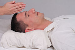 Man having reiki healing treatment , alternative  medicine concept. Stock Photo