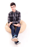 Man having rest in comfortable soft chair isolated Stock Photography