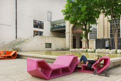 Man having rest in outdoor bench in modern style near Leopold Museum Stock Photos