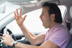 Man having road rage. In his car Stock Photo