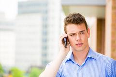 Man having serious conversation on cell phone Royalty Free Stock Photos