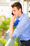 Man having serious conversation on cell phone Stock Images