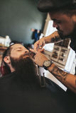 Man having a shave at the barber shop Royalty Free Stock Images