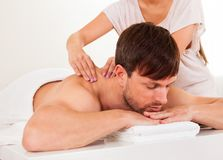 Man having a shoulder massage Royalty Free Stock Images