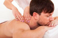 Man having a shoulder massage Royalty Free Stock Photos
