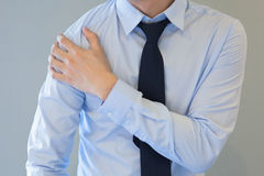 Man having shoulder pain problem Stock Image