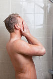 Man having a shower Royalty Free Stock Photos