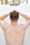 Man having shower outdoors. Stock Photos