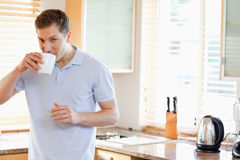 Man having a sip of coffee in the kitchen Royalty Free Stock Photo