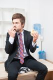 Man having a snack Stock Photography