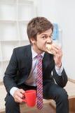 Man having a snack Royalty Free Stock Photos