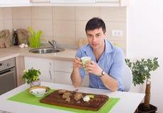 Man having snack Royalty Free Stock Photo