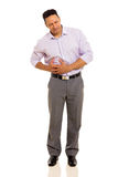 Man having stomach ache Royalty Free Stock Images