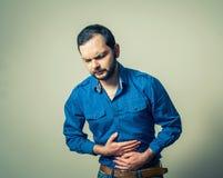 Man having stomach pain Royalty Free Stock Photo