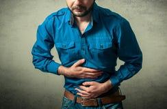 Man having  stomach pain Stock Photography