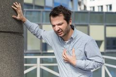 Man having  a sudden heart attack  and feeling bad Royalty Free Stock Photos